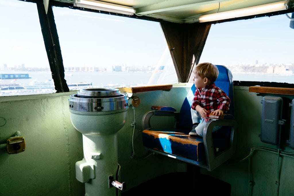 Things to do in NYC with Kids: The Intrepid captain's chair