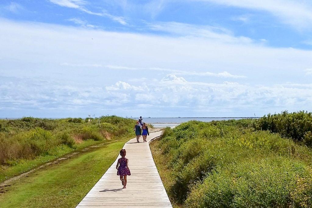 kid running boardwalk