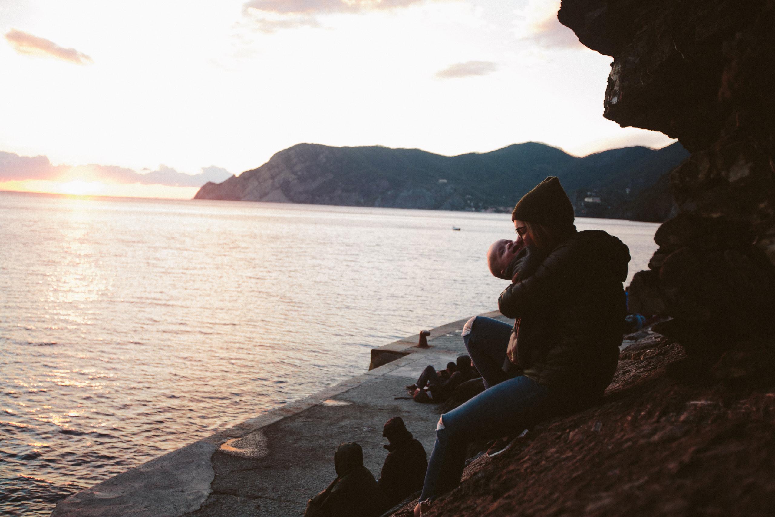 family travel ocean sunset