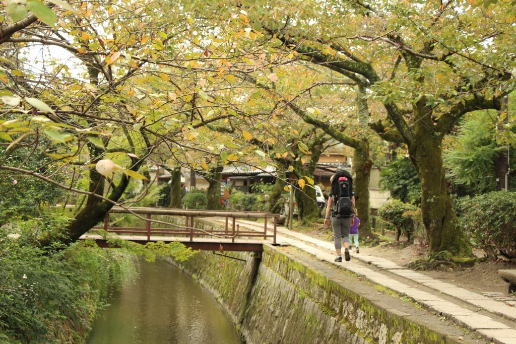 Kyoto Day Trip: Family walking stone-paved pathway of The Philosopher's Path in Kyoto, Japan.