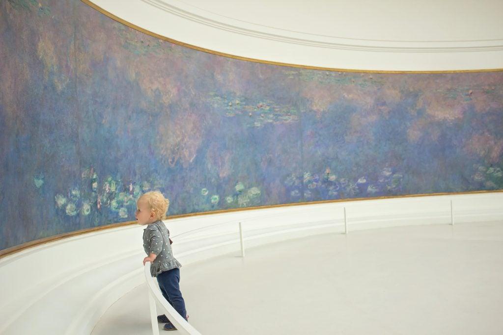 Paris with kids: A child viewing painting at Musée de l'Orangerie