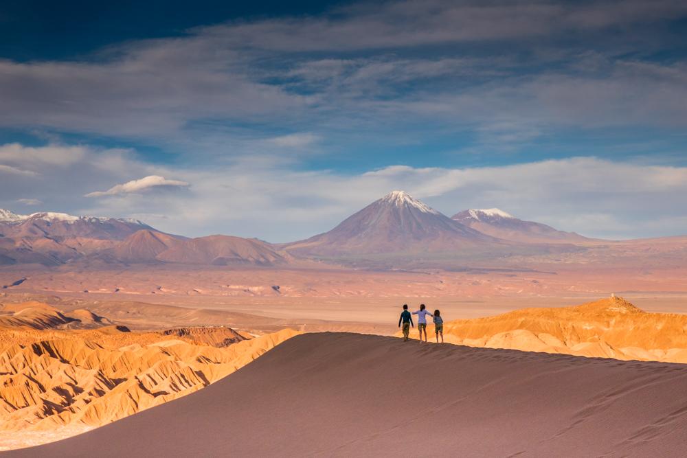 Family hiking through desert