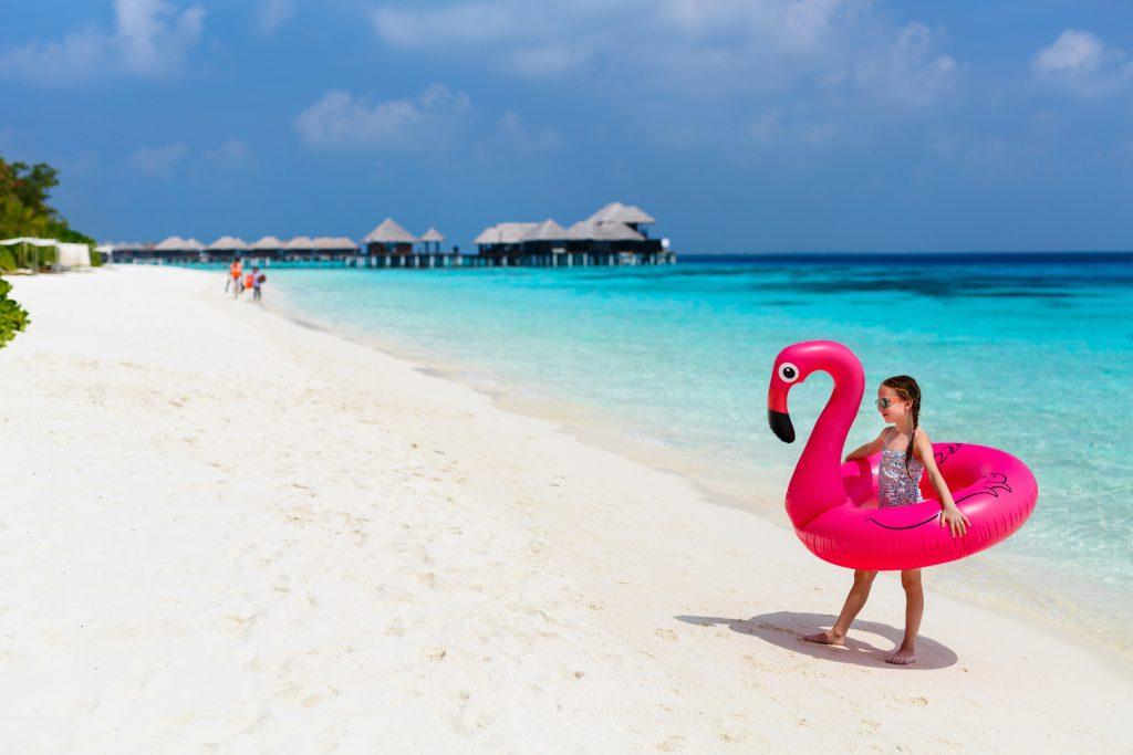Child enjoying beautiful Maldives beach