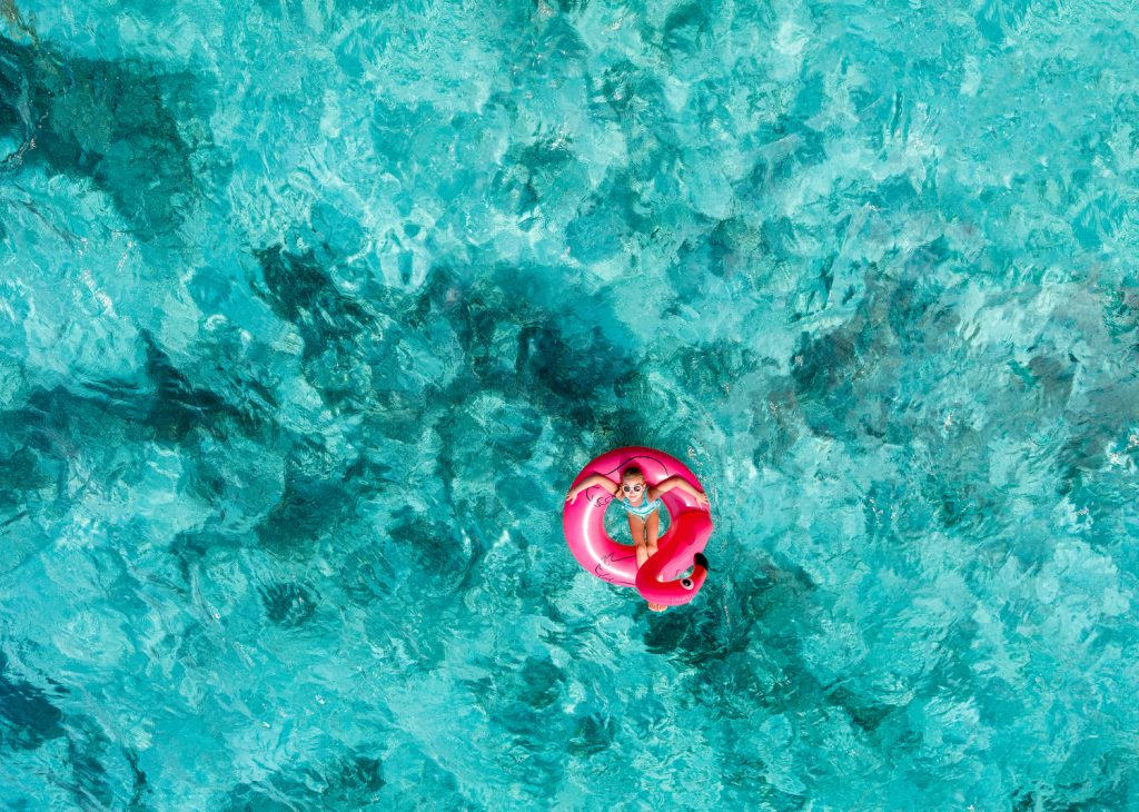 Floating in turquoise waters of Maldives