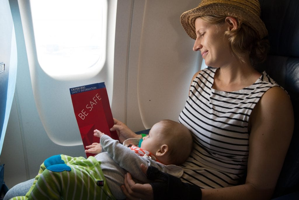flying with kids: baby and mom on plane