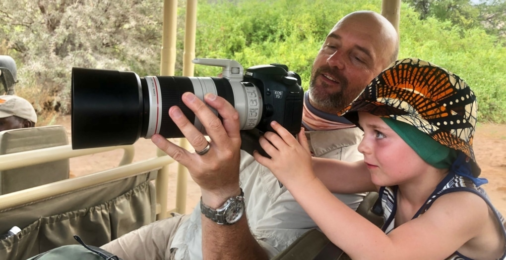 African Safari Holidays: dad teaching son how to use a camera