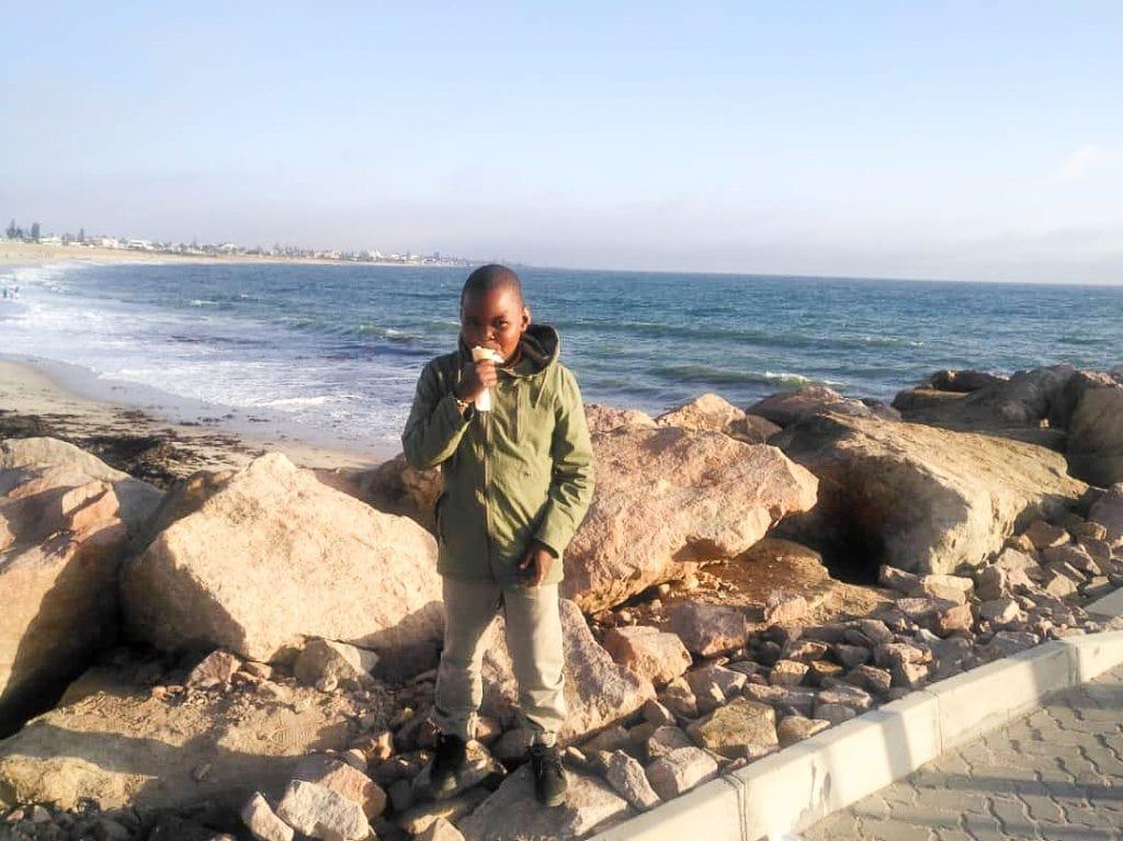 Africa for Kids: Boy at the Beach in Swakopmund