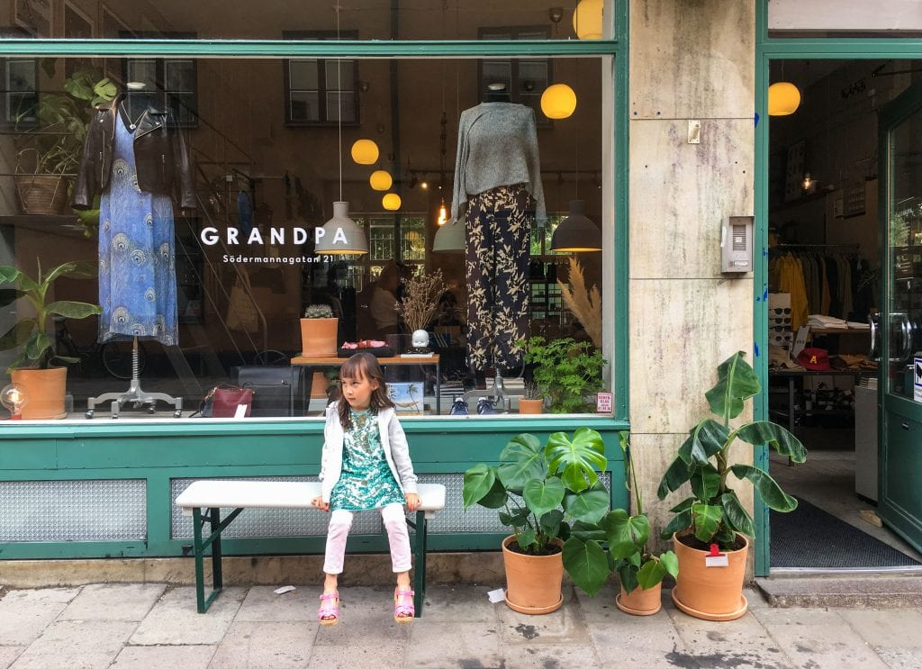 Things to do in Stockholm with kids: girl on bench in Södermalm