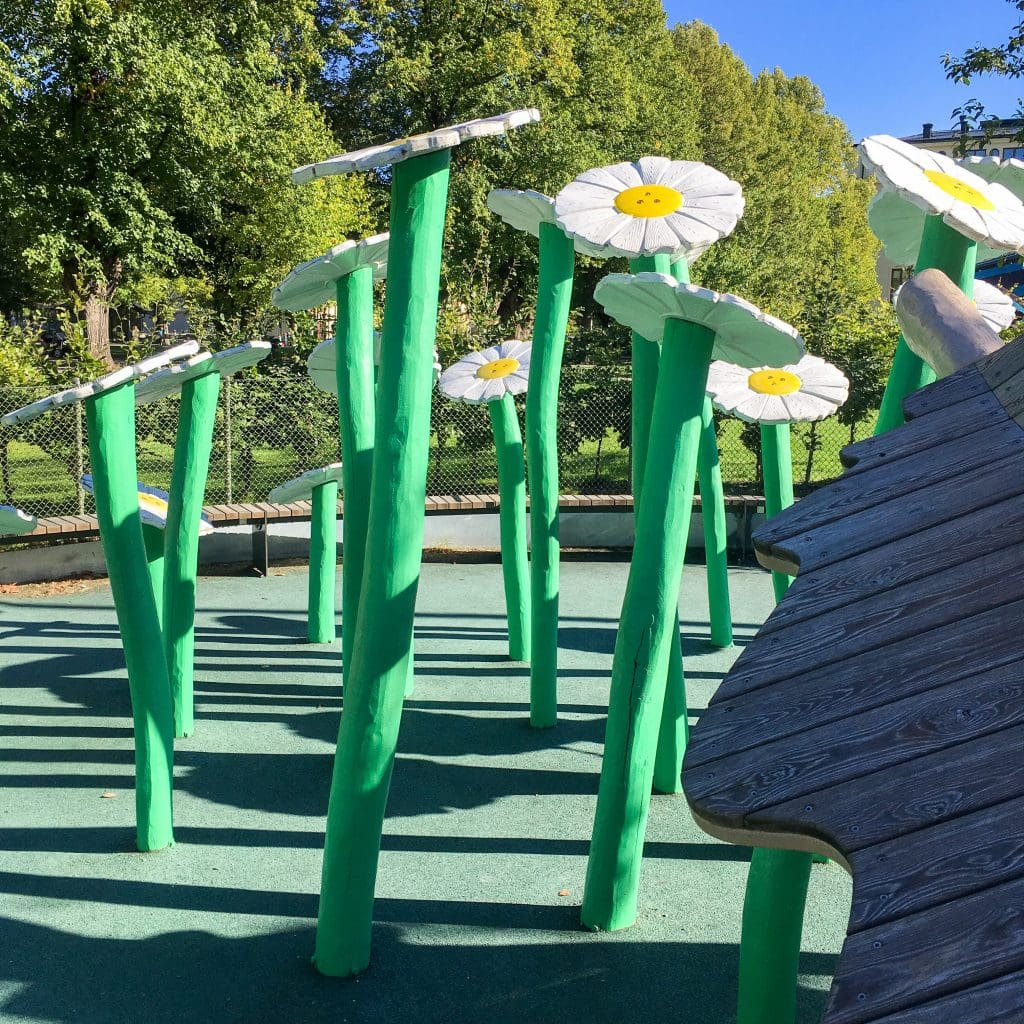 Things to do in Stockholm with kids: wooden flowers at Uggleparken playground